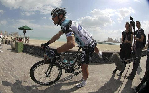 Omega Pharma-Quick Step's Mark Cavendish of Britain waits for the start of stage one of the 2013 Tour of Qatar from Katara Cultural Village