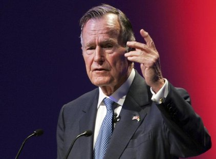 Former U.S. President George H.W. Bush speaks at the World Leadership Summit in Abu Dhabi, United Arab Emirates in this file photo taken Nov