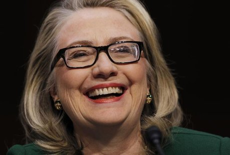 U.S.Secretary of State Hillary Clinton sits down to testify on the September attack on U.S. diplomatic sites in Benghazi, Libya during a hea