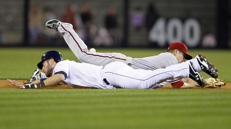 Arizona Diamondbacks' second baseman Aaron Hill (back) dives for the ball as San Diego Padres' right fielder Jeremy Hermida dives for second