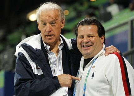 Vice President Joe Biden stands with 1980 Miracle on Ice legend Mike Eruzione at the women's U.S. vs. China hockey game at the Vancouver 201