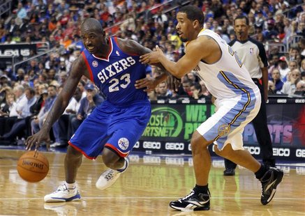 Philadelphia 76ers guard Jason Richardson (23) drives on the Denver Nuggets guard Andre Miller (R) during the second half of their NBA baske