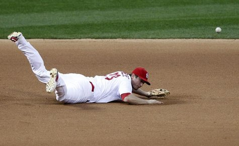 St. Louis Cardinals third baseman David Freese is unable to reach a single by San Francisco Giants' Buster Posey in the seventh inning durin
