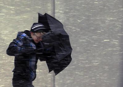 A pedestrian walks into wind-driven snow in Boston, Massachusetts February 8, 2013 at the beginning of what is forecasted to be a major winter snow storm. Credit: REUTERS/Brian Snyder