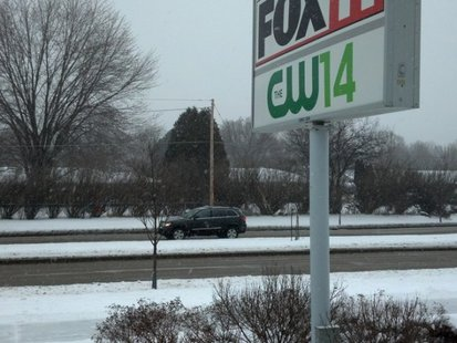 Flakes fly and snow begins to accumulate on a sidewalk as Winter Storm Elijah begins outside the FOX 11/CW 14 studios in Ashwaubenon. Credit: WLUK/Scott Hurley
