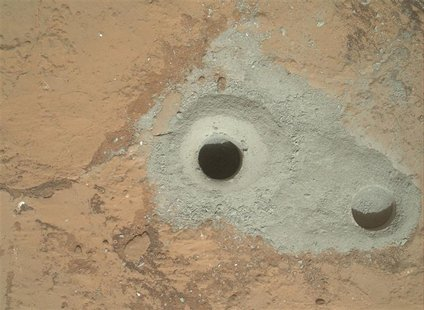 "At the center of this image released to Reuters on February 9, 2013 from NASA's Curiosity rover is the hole in a rock called ""John Klein"" wh"