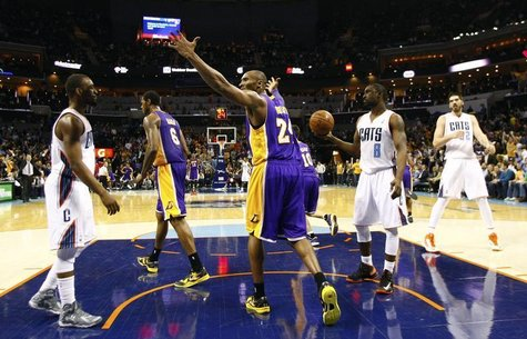 Los Angeles Lakers shooting guard Kobe Bryant (24) reacts after a play against the Charlotte Bobcats during the second half of their NBA bas