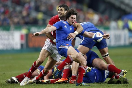 Maxime Machenaud of France (front) struggles with Mike Phillips of Wales (C, rear) during their Six Nations rugby match against France at th
