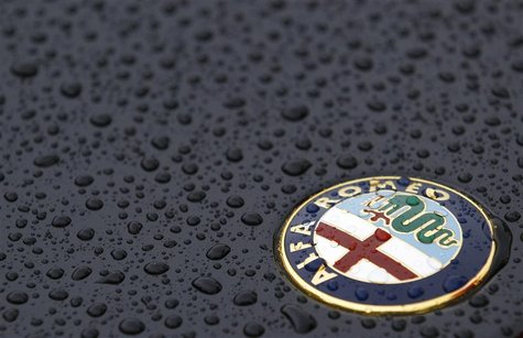 The Alfa Romeo logo is seen on an Alfa Romeo Spider during an Alfa Romeo classic car meeting in Fiuggi, south of Rome, June 9, 2012. REUTERS