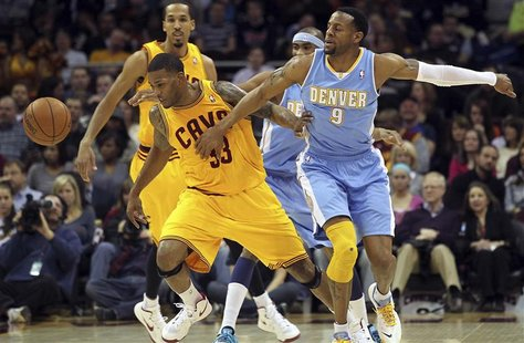 Cleveland Cavaliers Alonzo Gee (33) gets the ball knocked away by Denver Nuggets Andre Iguodala (9) during the first quarter of their NBA ba