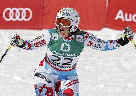 Marion Rolland of France reacts during the women's Downhill race at the World Alpine Skiing Championships in Schladming February 10, 2013. R