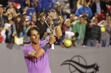 Spain's Rafael Nadal gestures after winning his men's singles match against France's Jeremy Chardy at the Chilean Open tennis tournament in