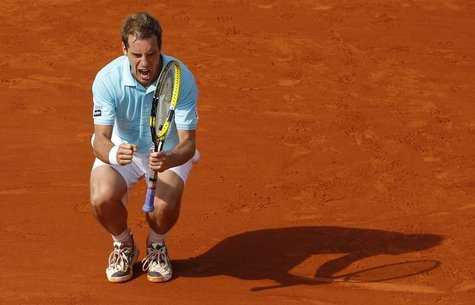 Richard Gasquet of France reacts during his match against Tommy Haas of Germany during the French Open tennis tournament at the Roland Garro