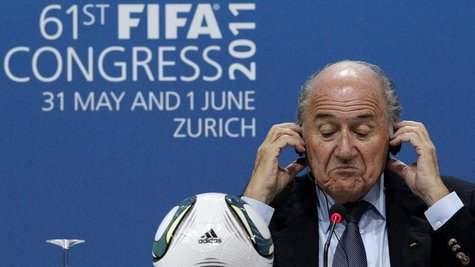 FIFA President Sepp Blatter reacts during a news conference after being re-elected for a fourth term as president of world soccer's governin