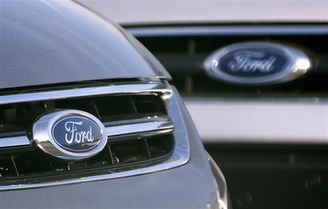The logo of Ford Motor Company is seen on vehicles in a parking lot at the Ford assembly plant in Genk October 23, 2012. REUTERS/Francois Le