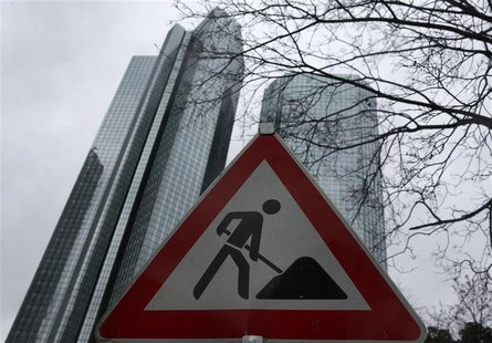 The headquarters of Germany's largest business bank, Deutsche Bank are seen behind a construction site warning sign in Frankfurt, January 30