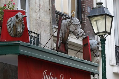 Metal horse heads are seen above a closed horsemeat butcher shop in Paris January 16, 2013. REUTERS/Charles Platiau (FRANCE - Tags: BUSINESS