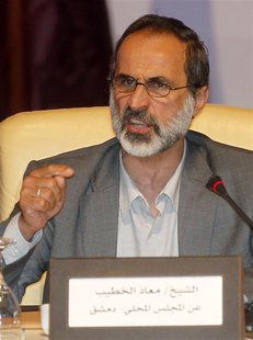 Activist preacher Mouaz al-Khatib speaks the General Assembly of the Syrian National Council in Doha November 11, 2012. REUTERS/Mohammed Dab