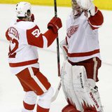 Detroit Red Wings' goalie Jimmy Howard (R) and Jonathan Ericsson celebrate their team's win. REUTERS/Joshua Lott