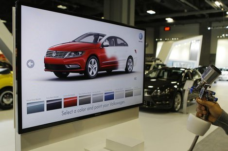 A unique Volkswagen consumer interactive display that allows potential buyers to spray paint different models in different colors is seen at