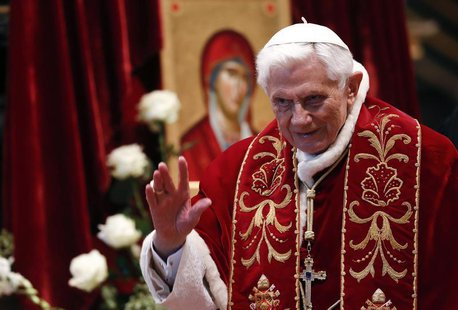 Pope Benedict XVI waves during a mass conducted by Cardinal Tarcisio Bertone, for the 900th anniversary of the Order of the Knights of Malta