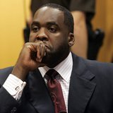 Former Detroit Mayor Kwame Kilpatrick sits in a Wayne County Circuit Court room during a bond hearing to request removal of his court ordere