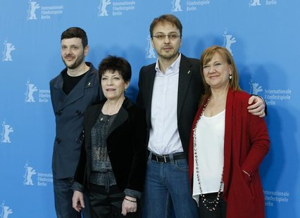 Actors Bogdan Dumitrache (L-R), Luminita Gheorghiu, director Calin Peter Netzer and producer Ada Solomon pose during a photocall to promote