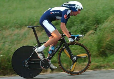 Joerg Jaksche of Germany cycles in pouring rain during the individual time-trial stage of the Tour de Suisse cycling race from Kerzers to Be