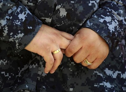Navy Counselor 1st Class Luz Bautista, a lesbian whose partner is also in the military, poses for a photo in Los Angeles, California Septemb