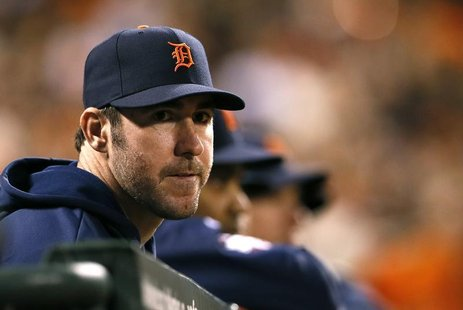 Detroit Tigers starting pitcher Justin Verlander watches from the dugout in the seventh inning during Game 1 of the MLB World Series basebal