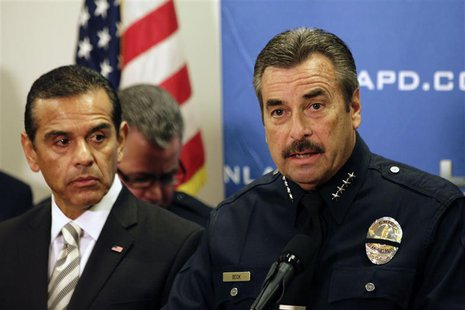 LAPD Police Chief Charlie Beck (R) speaks as Los Angeles Mayor Antonio Villaraigosa (L) looks on during a news conference at the LAPD Headqu