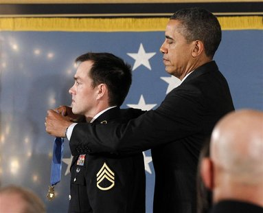 U.S. President Barack Obama awards the Medal of Honor to former active duty Army Staff Segeant Clinton Romesha during a ceremony in the East
