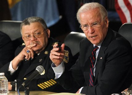 U.S. Vice President Joe Biden (R) makes remarks next to Philadelphia Police Commissioner Charles Ramsay at the conclusion of a roundtable di