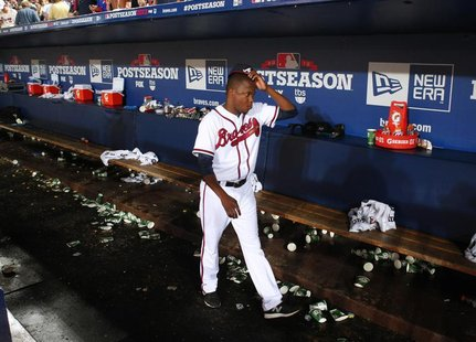 Atlanta Braves' Michael Bourn leaves the dugout at the end of their MLB National League Wild Card playoff baseball game against the St. Loui