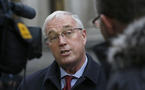 Union Cycliste Internationale (UCI) President Pat McQuaid speaks to reporters as he leaves a procedural hearing in London January 25, 2013.
