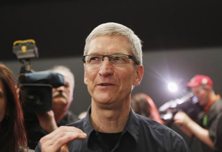 Apple CEO Tim Cook speaks in the demonstration room after the Apple event introducing the new iPad in San Francisco, California March 7, 201
