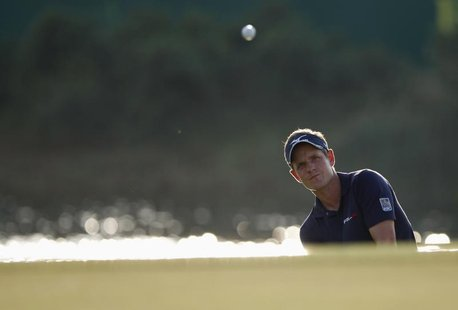 Luke Donald of Britain hits out of a bunker on the 17th hole during the final round of the DP World Tour Championship at Jumeirah Golf Estat