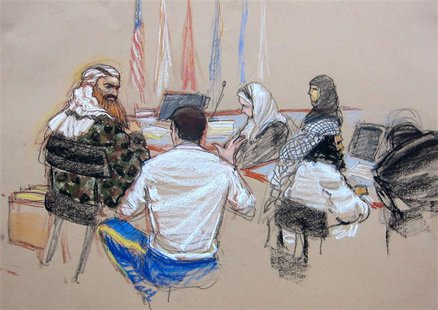 In this Pentagon-approved courtroom sketch, alleged 9/11 mastermind Khalid Sheikh Mohammad (L) confers with defense attorney Army Captain Ja