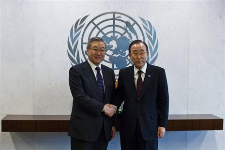 South Korea's Foreign Minister Kim Sung-Hwan (L) shakes hands with United Nations General Secretary Ban-Ki Moon at the U.N. headquarters in