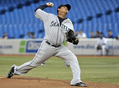 Seattle Mariners pitcher Felix Hernandez throws against the Toronto Blue Jays during the first inning of their MLB American League baseball