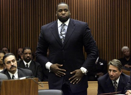 Former Detroit Mayor Kwame Kilpatrick stands in the courtroom during his sentencing hearing where he received 120 days in jail in Detroit, M