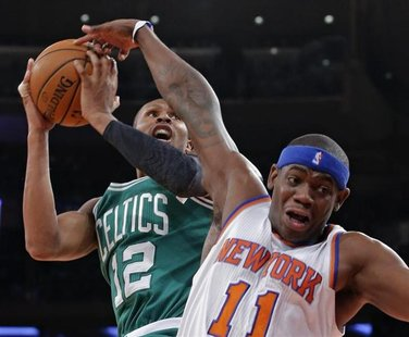 New York Knicks forward Ronnie Brewer (11) fouls Boston Celtics guard Leandro Barbosa (12) in the second quarter of their NBA basketball gam