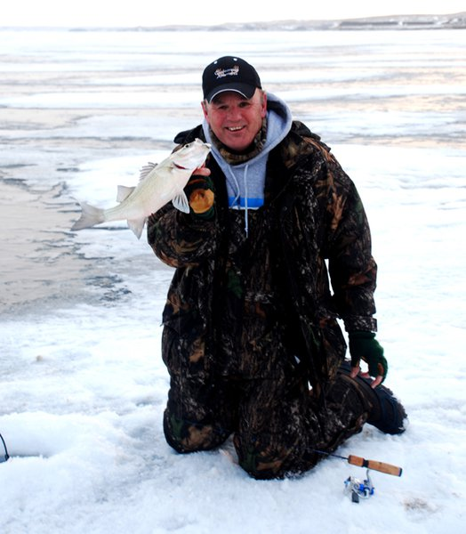 Outdoorsmen Adventures TV host Gary Howey with a white bass caught on Lake Oahe.