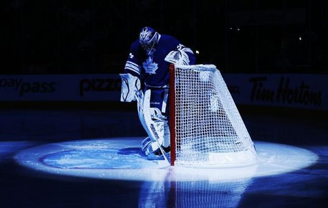 Toronto Maple Leafs goalie James Reimer is seen in the pre-game spotlight before they play the Philadelphia Flyers in their NHL hockey game