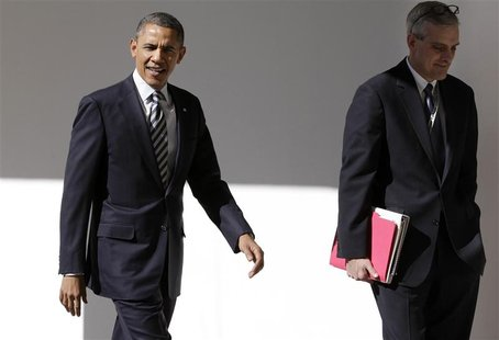 U.S. President Barack Obama (L) walks with Denis McDonough, the White House Chief of Staff, through the colonnade of the White House in Wash