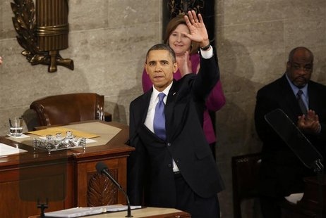 U.S. President Barack Obama waves at the conclusion of his State of the Union speech on Capitol Hill in Washington, February 12, 2013. REUTE