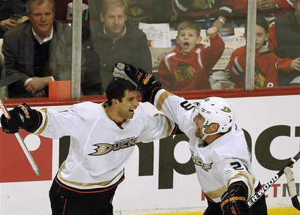 Anaheim Ducks' Andrew Cogliano (L) celebrates his goal with teammate Francois Beauchemin during the third period of their NHL hockey game ag