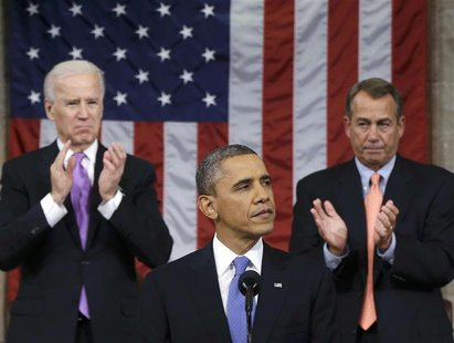 U.S. House Speaker John Boehner (R-OH) and Vice President Joe Biden (L) stand to applaud as President Barack Obama delivers his State of the