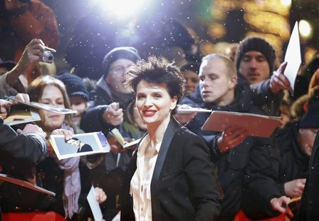 "Fans react as actress Juliette Binoche arrives at the red carpet for the screening of the movie ""Camille Claudel 1915"" at the 63rd Berlinale"