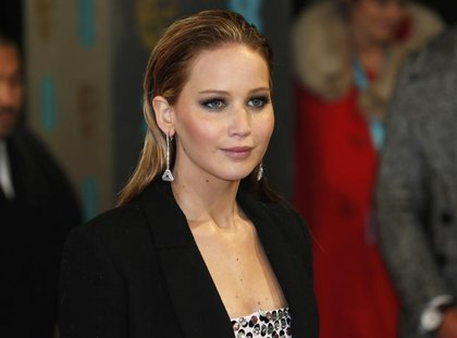 Actress Jennifer Lawrence poses as she arrives for the British Academy of Film and Arts (BAFTA) awards ceremony at the Royal Opera House in